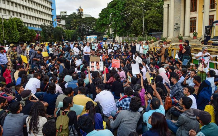 Protestors hold placards and raise slogans protesting against the amended Citizenship Act and police atrocities on students demonstrating over CAA, in Bengaluru, Monday, Dec. 16, 2019. (PTI Photo)