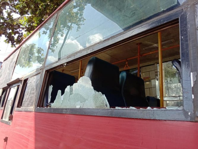 A NWKRTC bus damaged in the stone pelting after a few protesters went berserk in Belagavi on Tuesday. DH PHOTO