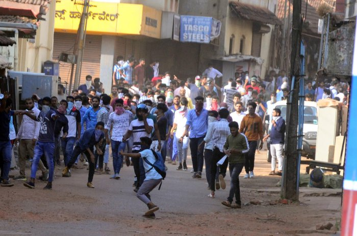 Protesters pelt stones at police during a protest against the Citizenship Amendment Act in Mangaluru on Thursday.