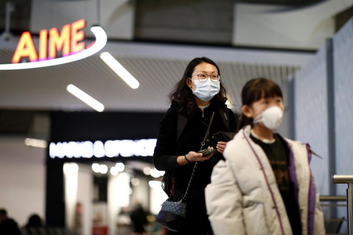 Tourists from an Air China flight from Beijing wear protective masks as they arrive at Charles de Gaulle airport in Paris, France, January 26, 2020. (Reuters Photo)