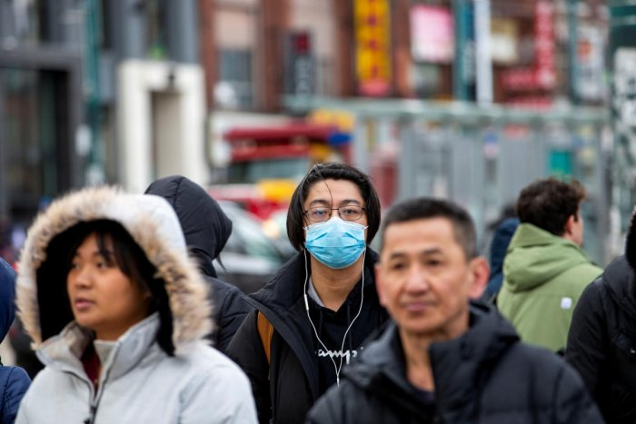 A man wearing a mask walks in the Chinatown district of downtown Toronto, Ontario, after 3 patients with novel coronavirus were reported in Canada January 28, 2020. (Reuters photo)