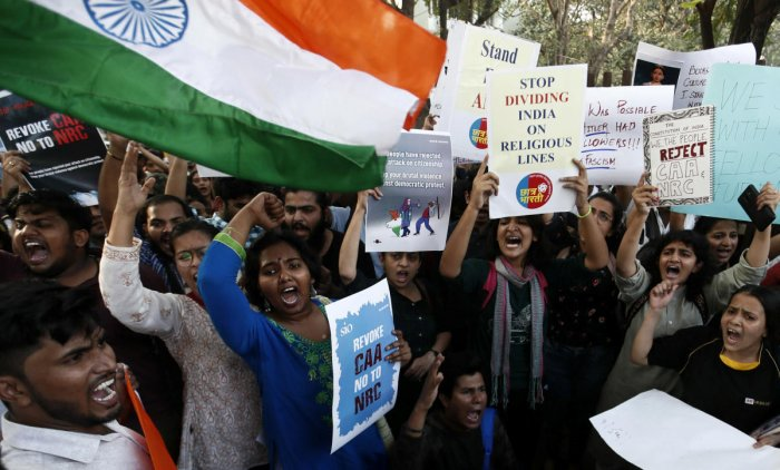 Students hold placards and shout slogans in solidarity with Jamia Millia Islamia university students after police entered the campus on Sunday in New Delhi, following a protest against a new citizenship law, in Mumbai. PTI