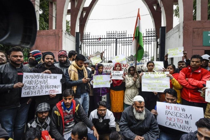 Students along with general public hold placards during a protest against the Citizenship Amendment Act (CAA), outside Jamia Millia Islamia University in New Delhi, Tuesday, Dec. 17, 2019. Photo/PTI