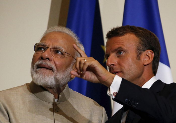 French President Emmanuel Macron with Prime Minister Narendra Modi. (AP/PTI photo)