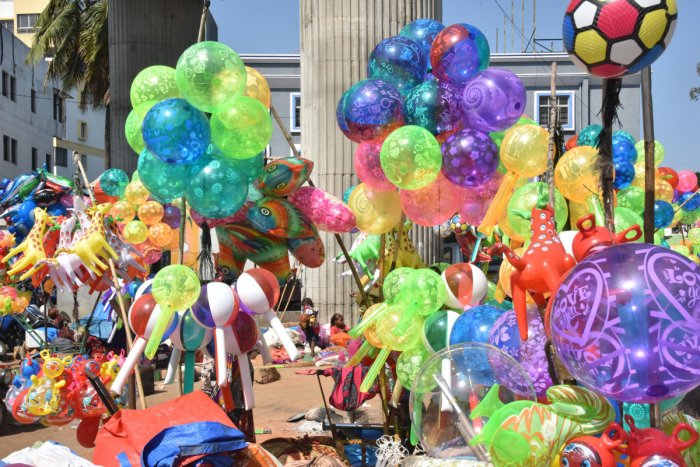 Many of street vendors along with family comes from different places for making colorful balloons for life leading at Vijayanagar in Bengaluru on Saturday, 23 November, 2019. Photo by Janardhan B K