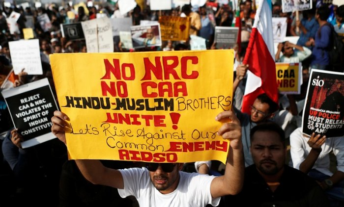 Demonstrators hold placards during a protest against a new citizenship law in Mumbai. (Reuters Photo)