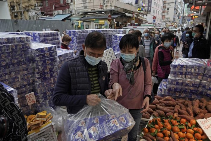 Customers wearing masks buy bath tissue papers at a store in Hong Kong
