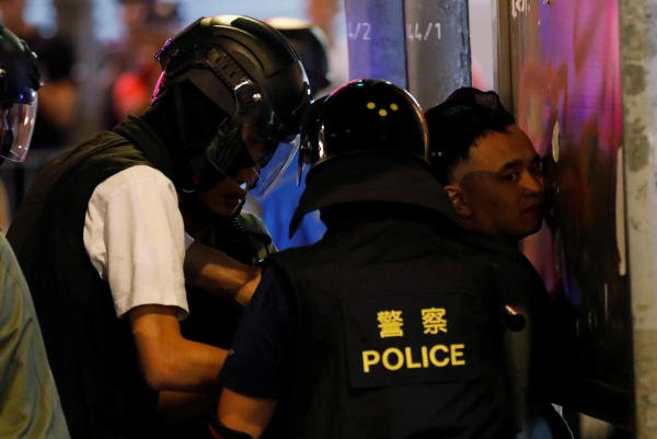 The temporary injunction, uploaded on government websites overnight, was criticised by some on Saturday for its broad wording and for further shielding the identity of officers as they clash with protesters. Photo/Reuters