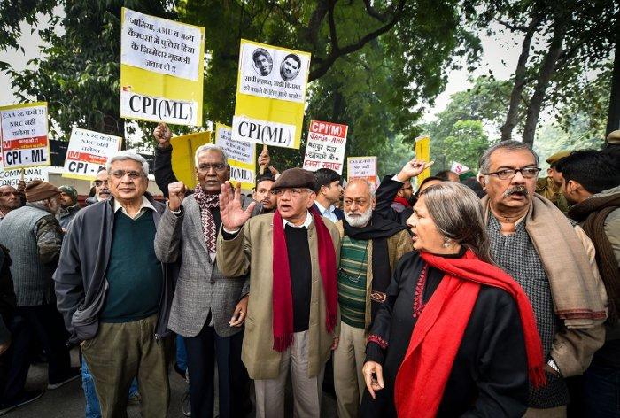 Left leaders D Raja, Sitaram Yechury, Nilotpal Basu, Brinda Karat, Prakash Karat and others raise slogans during an anti-Citizenship Act protest, at Mandi House, in New Delhi. (PTI Photo)