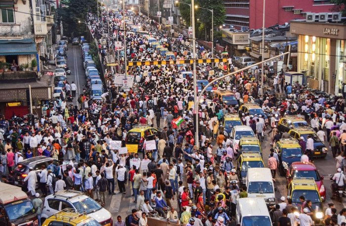 Protesters participate in a rally against the amended Citizenship Act and NRC, at August Kranti Maidan in Mumbai. (PTI Photo)