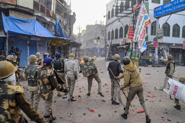 Police personnel clash with protestors during a rally against the Citizenship Amendment Act (CAA), in , in Kanpur. (PTI Photo)
