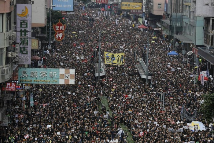 Tens of thousands of protesters march through the streets as they continue to protest an extradition bill, Sunday, June 16, 2019, in Hong Kong. Hong Kong residents were gathering Sunday for another massive protest over an unpopular extradition bill that has highlighted the territory's apprehension about relations with mainland China, a week after the crisis brought as many as 1 million into the streets. AP/PTI