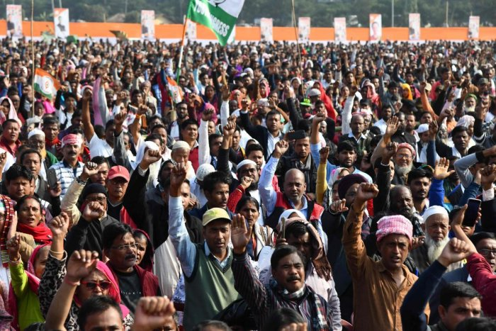 Congress Party activists and supporters shout slogans during a rally against India's new citizenship law, in Guwahati. AFP