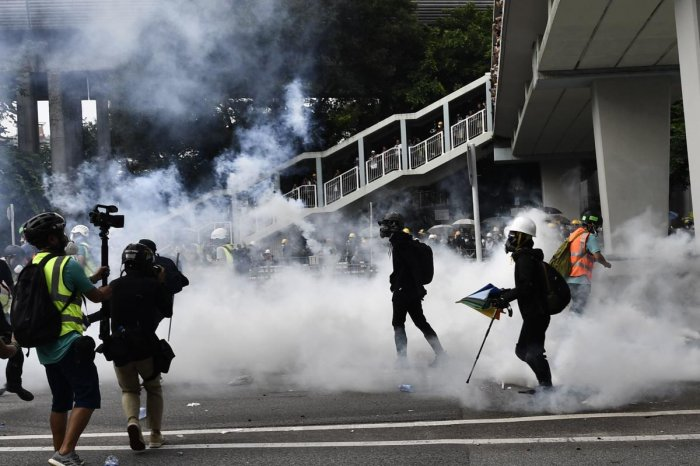 Hong Kong police fire tear gas during demonstration in the district of Yuen Long in Hong Kong on July 27, 2019. Photo credit: AFP