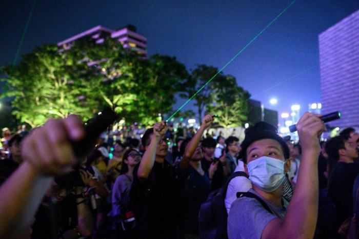 Protesters point lasers at the Space Museum during a demonstration in Hong Kong on August 7, 2019, in the latest opposition to a planned extradition law that has quickly evolved into a wider movement for democratic reforms. (Photo AFP)