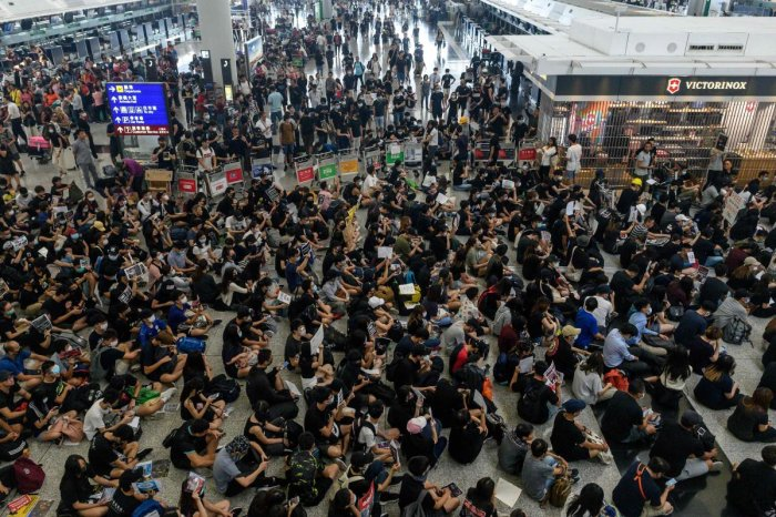 The Hong Kong Airport on Monday cancelled flights after protesters stormed in the arrival halls wearing eye patches and bandages opposing a bill that allows extraditions to mainland China. (AFP Photo)