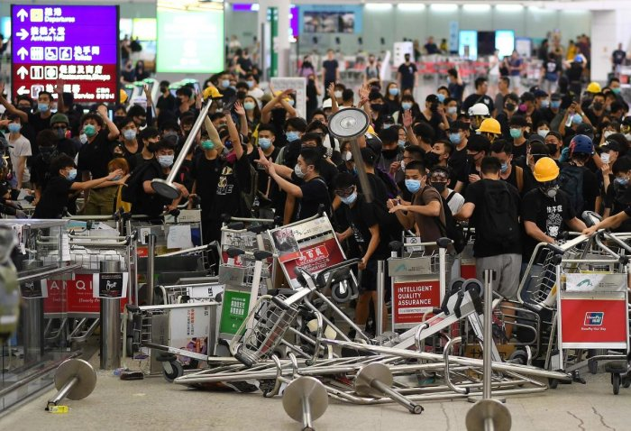Pro-democracy protestors block the entrance to the airport terminals after a scuffle with police at Hong Kong's international airport. AFP photo