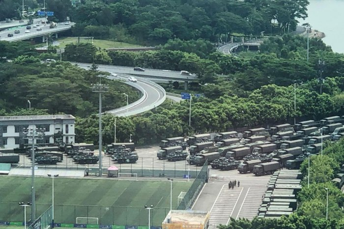 Trucks and armoured personnel carriers are seen outside the Shenzhen Bay stadium in Shenzhen, bordering Hong Kong in China's southern Guangdong province, on August 15, 2019.Photo by STR/AFP