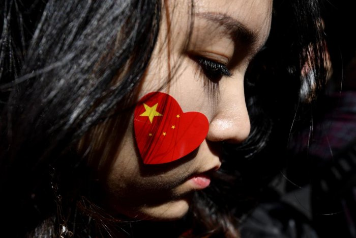 A pro-China activist marches on the streets of Sydney during a rally against ongoing protests in Hong Kong. AFP Photo