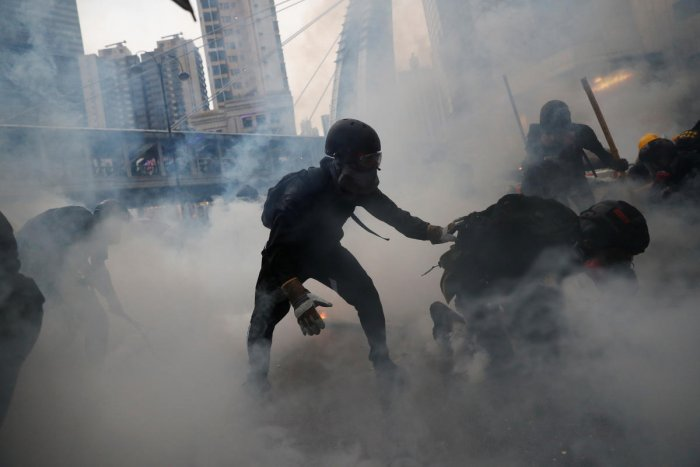Demonstrators are surrounded by tear gas during a protest in Tsuen Wan, in Hong Kong (Reuters photo)