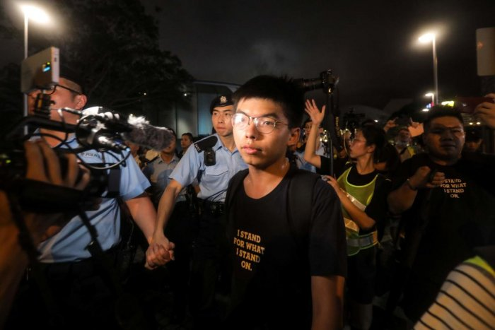 Pro-democracy activist Joshua Wong looks on as he confronts police after taking part in a march to the West Kowloon rail terminus against the proposed extradition bill in Hong Kong. He was arrested on August 30, 2019, his party said, a day ahead of a plan