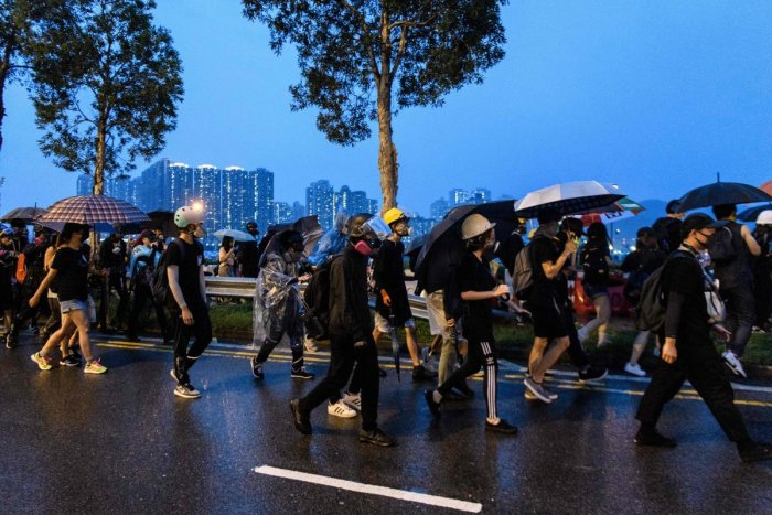A large group of protesters, try to find a safe area, who left their positions after frontliners told them to leave following the arrival of a police water cannon, during a protest in Tsuen Wan, an area in the New Territories in Hong Kong. AFP