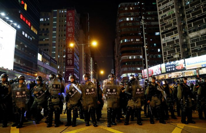 Riot police officers are seen near Mong Kok police station in Hong Kong. (Reuters Photo)