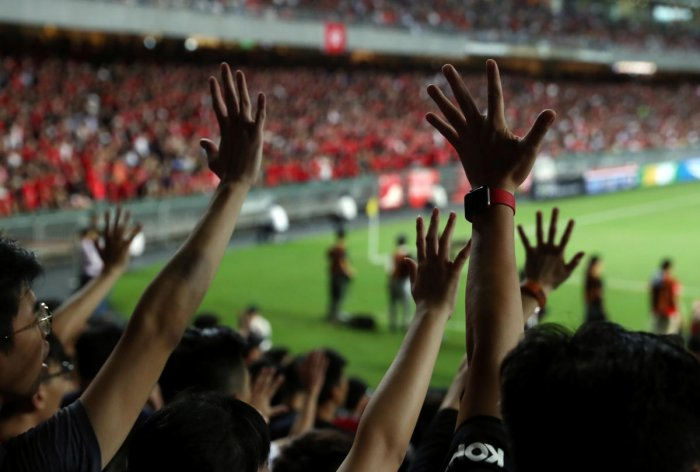 Soccer fans gesture their hands in support of anti-government protesters during a football World Cup qualifier match between Hong Kong and Iran, at Hong Kong Stadium, China September 10, 2019. (REUTERS)