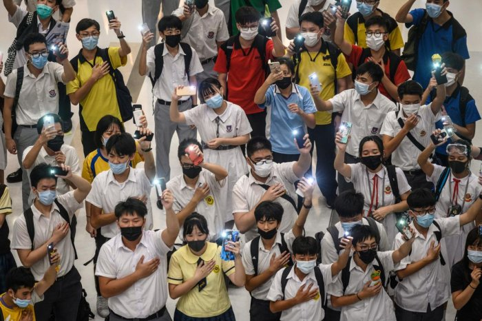 Anti-government protesters have thrown petrol bombs at police and central government offices, stormed the Legislative Council, blocked roads to the airport, trashed metro stations and lit fires on the streets. AFP Photo