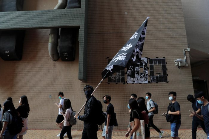 Students at Hong Kong Baptist University take part in a rally after police entered the campus on Sunday while chasing protesters, in Hong Kong, China October 8, 2019. (REUTERS)