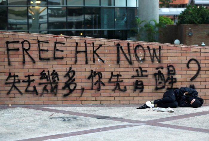 Around 100 protesters remain barricaded inside Hong Kong Polytechnic University (PolyU) surrounded by riot squads who have been besieging them for three days.