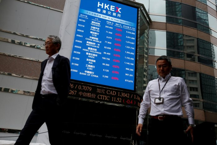 A panel outside the Hong Kong Exchanges displays top active securities during morning trading in Hong Kong, China. (Photo by Reuters)