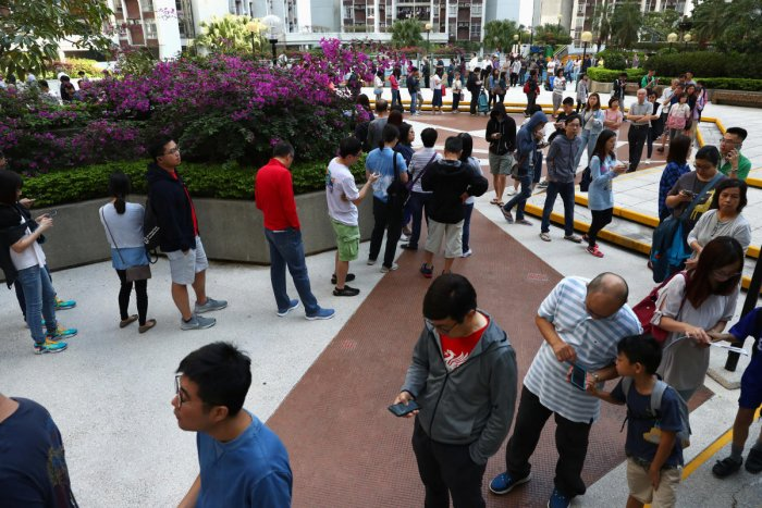 Voters queue to vote at a polling station during district council local elections on Hong Kong Island, China. (Reuters Photo)