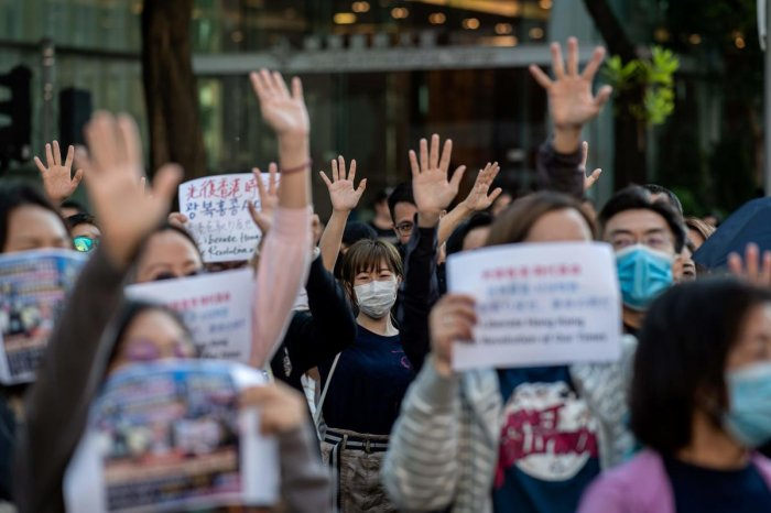People gather in support of pro-democracy protesters during a lunch break rally in the Kwun Tong area in Hong Kong on November 27, 2019. - Hong Kong has been battered by months of mass rallies and violent clashes pitting police against protesters who are