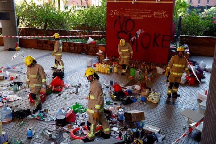 Firefighters examine debris left by protesters at the campus of the Polytechnic University (PolyU) in Hong Kong, China. Reuters Photo