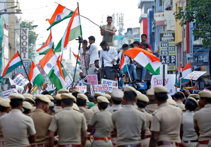 Police officers stand guard as demonstrators attend a protest march against a new citizenship law, in Chennai, India, December 22, 2019. (Reuters Photo)