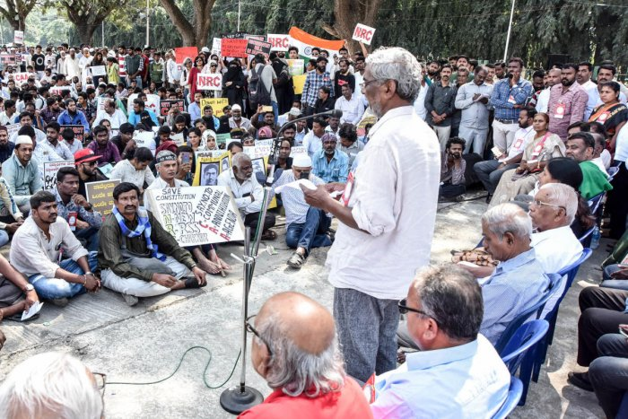 Writer Devanuru Mahadeva speaks during a protest held to oppose CAA and NRC at Rangacharlu Town Hall, in Mysuru on Tuesday. dh photo
