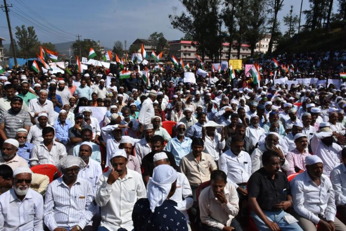 Protesters gather at Gandhi Maidan, as a part of a protest meet organised by Kodagu Muslim Jama at Okkoota in Madikeri on Tuesday. DH Photo