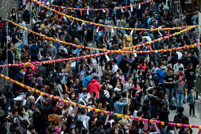 people taking part in a Lunar New Year fair organised by pro-democracy district councillors in the Sai Ying Pun district in Hong Kong. (AFP PHOTO)