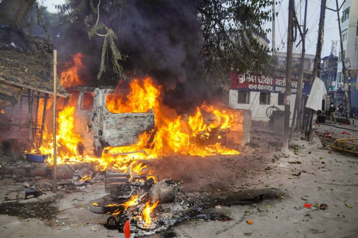 A vehicle torched allegedly by protestors during a demonstration against the Citizenship Amendment Act (CAA) in UP. (PTI file photo)