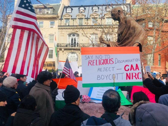 Organised by American-Indian Muslims in association with over a dozen of similar bodies, peaceful protestors from in and around the Greater Washington Area on Sunday shouted slogans in favour of India's unity and displayed posters and banners alleging that the country was headed in a direction that was not secular in nature and violated the ethos of the Constitution. Photo/Twitter (@RRemediator)