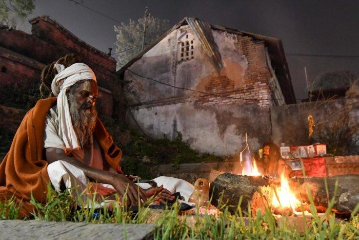 A Sadhu sits next to a bonfire near the Pashupatinath Temple in Kathmandu. (AFP Photo)