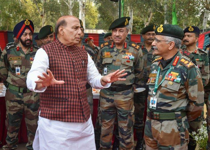 Defence Minister Rajnath Singh interacts with Army Chief General Manoj Mukund Naravane. (PTI Photo)