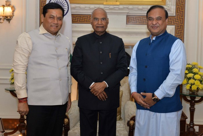 President Ram Nath Kovind with Assam Chief Minister Sarbananda Sonowal and State Finance and Health Minister Himanta Biswa Sarma. (PTI Photo)