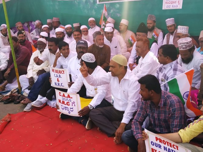 Raising slogans against Prime Minister Narendra Modi and Union Home Minister Amit Shah, they demanded the withdrawal of the CAA and not to implement NRC.(DH Photo)