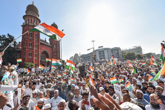 Protestors wave tri-colours during a demonstration against the Citizenship Amendment Act (CAA), in Chennai, Friday, Jan. 24, 2020. (PTI Photo)