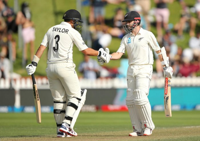 New Zealand's Kane Williamson celebrates his half century with Ross Taylor (REUTERS Photo)