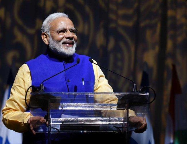 PM invokes GST spirit for success of session