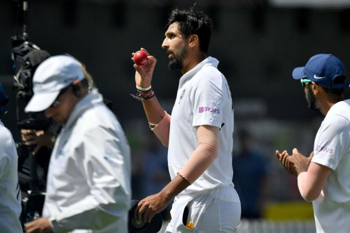 Ishant Sharma celebrates a 5 wicket bag as he walks from the field at lunch during day three of the first Test cricket match between New Zealand and India. (AFP Photo)