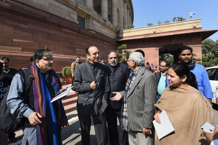 Congress leaders Ghulam Nabi Azad (2nd L) and Anand Sharma (C) with CPI(M) General Secretary Sitaram Yechury and RJD's Manoj Jha (L) and Misa Bharti (R) at Parliament, on the first day of the Budget Session, in New Delhi. (PTI Photo)